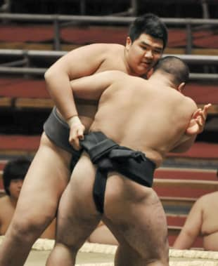 Hokuseiho (left) fights in maezumo, the lowest-ranked division, on March 9 at Edion Arena Osaka in Osaka.   KYODO