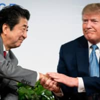 If U.S. President Donald Trump is re-elected, Washington is expected to push Tokyo to shoulder a bigger burden to support U.S. forces stationed in Japan. | ERIN SCHAFF / THE NEW YORK TIMES