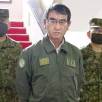 Defense Minister Taro Kono speaks to reporters as he visits the Ground Self-Defense Force's Signal School in Yokosuka on July 23. | KYODO