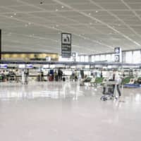 Narita Airport is seen deserted Aug. 8 amid the continued spread of the novel coronavirus. | KYODO
