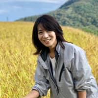 Quality control: Fifth-generation brewery owner Rumiko Obata checks the rice used to make sake at her family's brewery on Sado Island. | COURTESY OF OBATA SHUZO