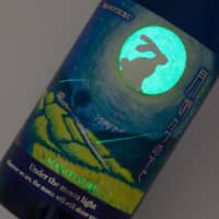 Light at the end of the tunnel: The bottle labels for Obata Shuzo's 'Under the Same Sky' sake series glow in the dark. | COURTESY OF OBATA SHUZO