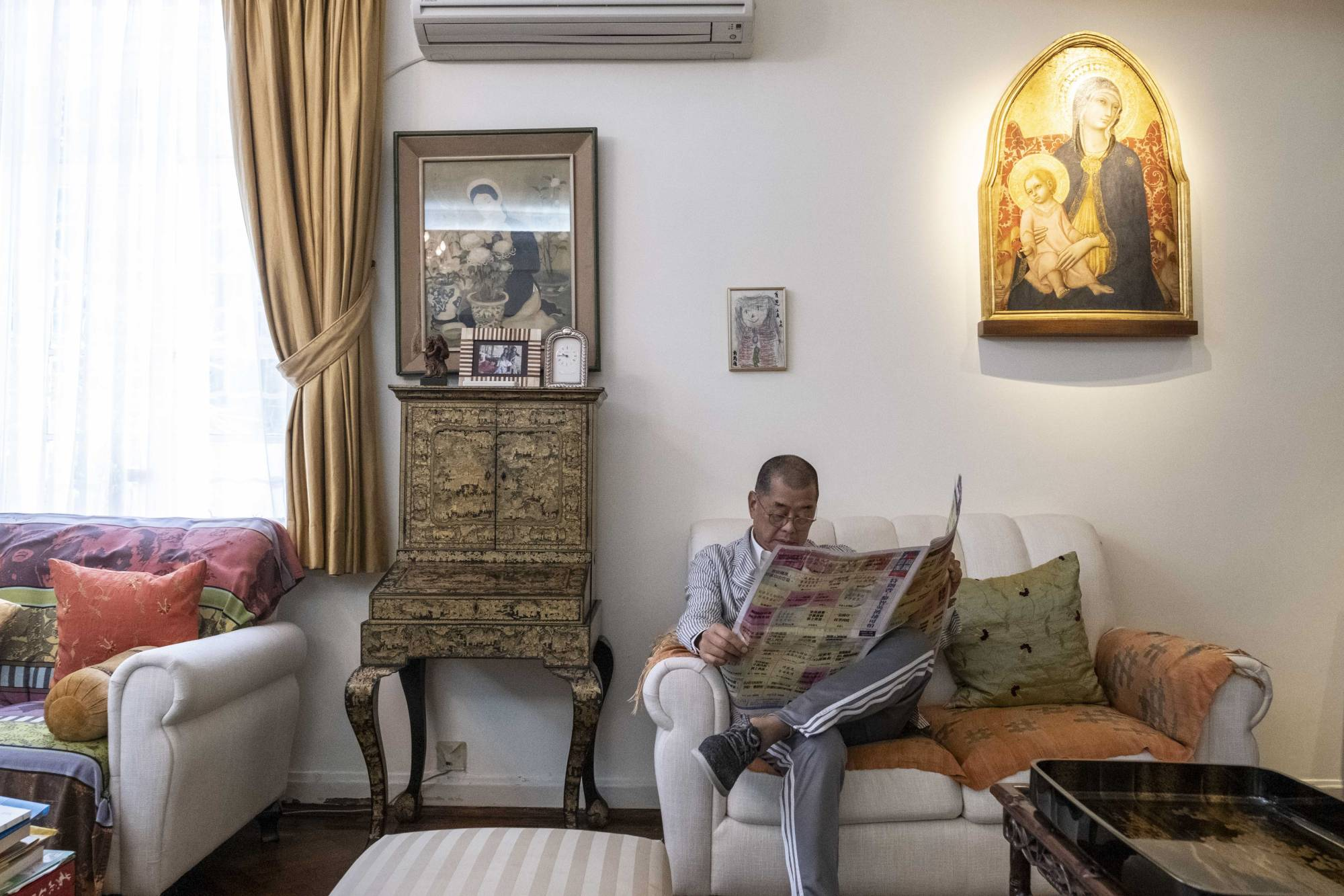 Jimmy Lai sits at his home in Hong Kong a few days after he was arrested by police under the city's new national security law. | LAM YIK FEI/THE NEW YORK TIMES