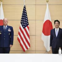 Prime Minister Shinzo Abe meets with U.S. Chief of Space Operations Gen. John Raymond at the Prime Minister's Official Residence in Tokyo on Thursday. | KYODO