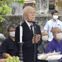 Masakatsu Takara, a survivor of the attack on the Tsushima Maru, offered a prayer during a ceremony on Aug. 22 in Naha, Okinawa Prefecture. | KYODO