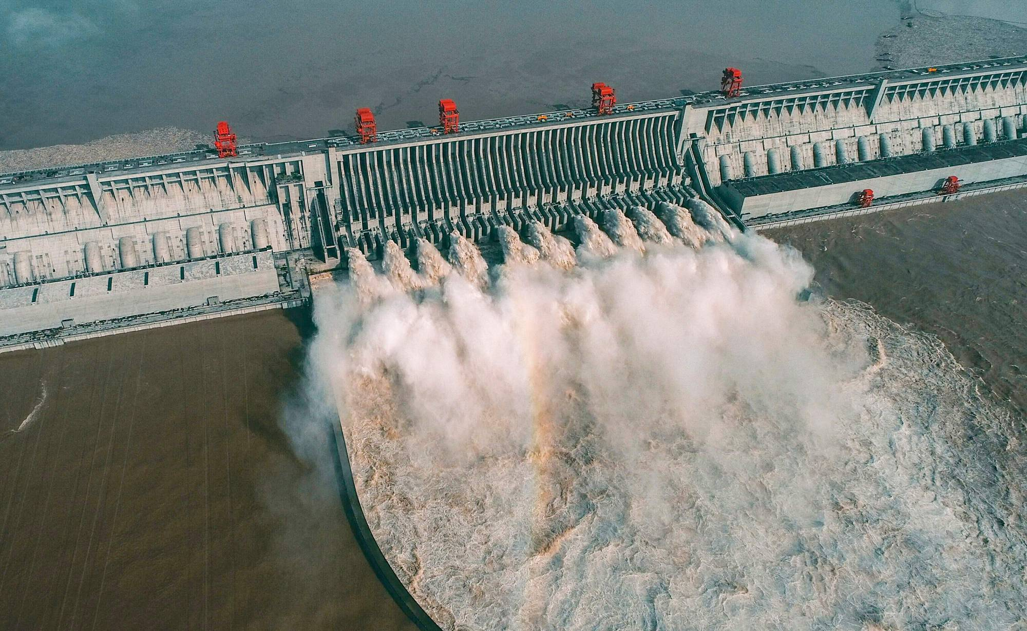 This aerial photo taken on Aug. 23 shows water being released from China's Three Gorges Dam in Yichang, Hubei province. | AFP-JIJI