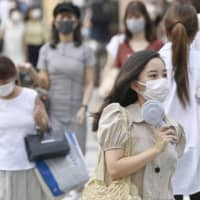 Tokyo reported 226 new coronavirus cases on Friday.  | KYODO