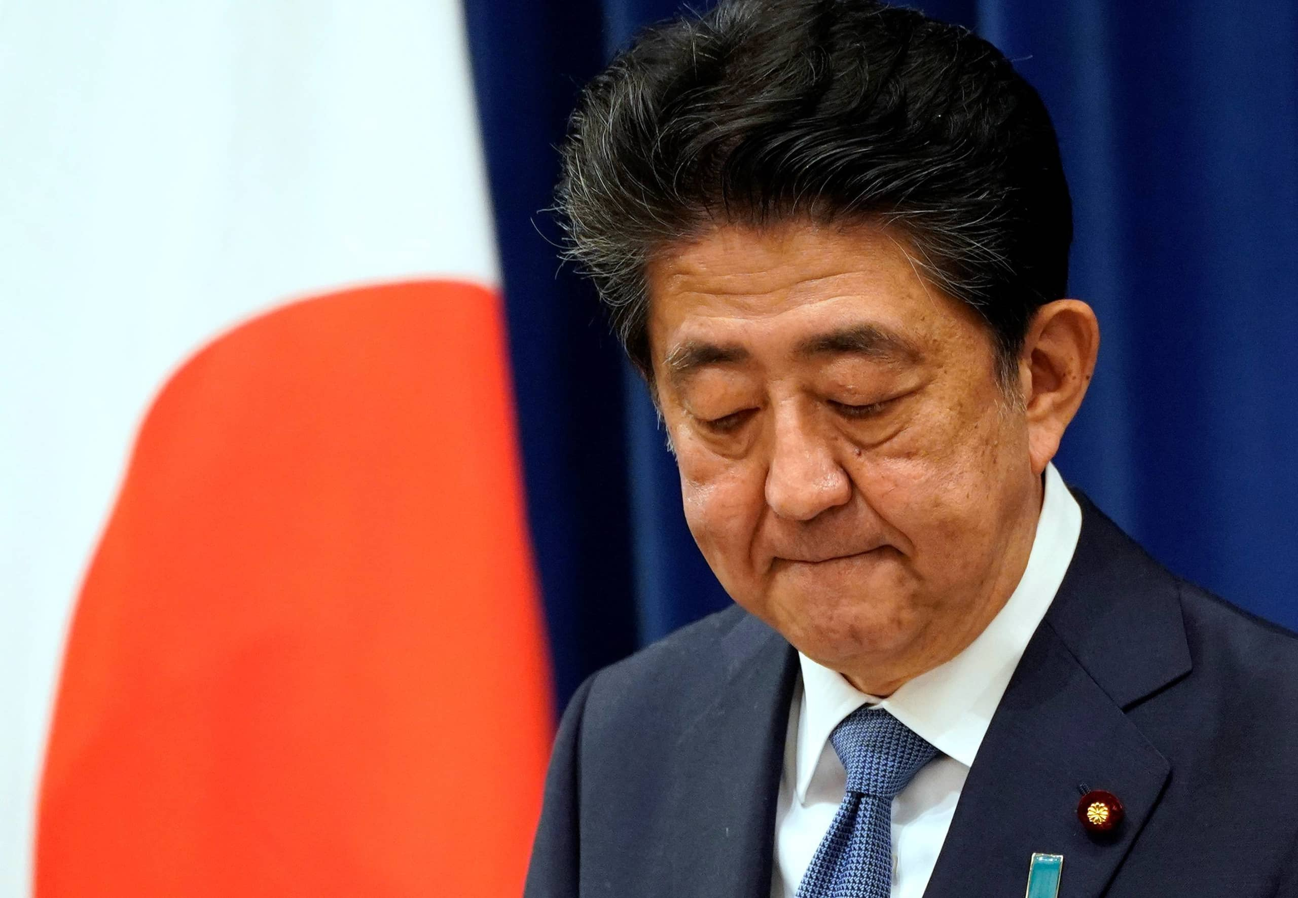 Prime Minister Shinzo Abe reacts during a news conference at the Prime Minister's Office in Tokyo on Friday. | POOL / VIA REUTERS