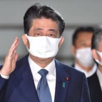 Prime Minister Shinzo arrives at the Prime Minister's Office in Tokyo on Friday. | AFP-JIJI