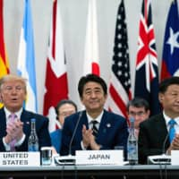 U.S. President Donald Trump, Prime Minister Shinzo Abe and Chinese President Xi Jinping participate in Group of 20 talks in Osaka in June 2019. | ERIN SCHAFF / THE NEW YORK TIMES