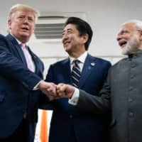 President Donald Trump greets Prime Minister Shinzo Abe and Indian Prime Minister Narendra Modi at the Group of 20 summit in Osaka in June 2019. | ERIN SCHAFF / THE NEW YORK TIMES