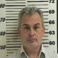 Michael Taylor, who was implicated in enabling the dramatic escape of former Nissan Motor Co. boss Carlos Ghosn, is seen in a booking photograph from October 2012 on unrelated charges. | DAVIS COUNTY SHERIFF'S OFFICE / VIA REUTERS