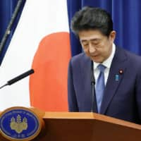 Prime Minister Shinzo Abe bows after announcing his intention to resign at a news conference in Tokyo on Friday, citing a flare-up of his long-running intestinal illness. | KYODO