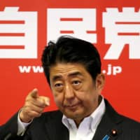 Prime Minister and leader of the ruling Liberal Democratic Party Shinzo Abe attends a news conference following a victory in the Upper House elections by his ruling coalition, at LDP headquarters in Tokyo in July 2016.  | REUTERS