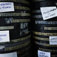 Film reels are stored at the Ambasciatori, Rome's last porn cinema theater, on Wednesday. | AFP-JIJI