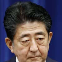 Prime Minister Shinzo Abe announces his intention to resign at a news conference in Tokyo on Friday.   KYODO