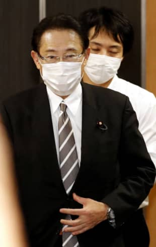 Liberal Democratic Party policy chief Fumio Kishida leaves LDP headquarters in Tokyo on Friday.   KYODO
