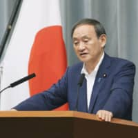 Chief Cabinet Secretary Yoshihide Suga speaks during a news conference at the Prime Minister's Office on Friday. | KYODO