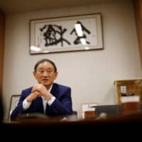 Chief Cabinet Secretary Yoshihide Suga, the government's spokesman, speaks during an interview in Tokyo on Wednesday. | REUTERS