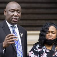 Attorney Ben Crump speaks during a news conference alongside Tamika Palmer, Breonna Taylor's mother, in Louisville, Kentucky, earlier this month. | COURIER JOURNAL / VIA AP