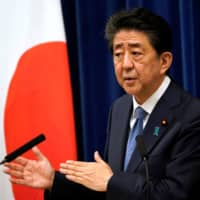 Prime Minister Shinzo Abe speaks during a news conference in Tokyo on Friday. | POOL / VIA REUTERS