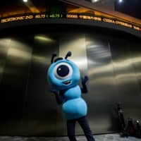 Ant Group aims to raise at least $30 billion in Hong Kong and Shanghai in October, which could push global first-time share sales by tech firms well past $57 billion. | BLOOMBERG