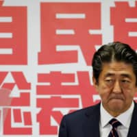 Prime Minister Shinzo Abe attends a news conference after winning the ruling Liberal Democratic Party leadership vote at party headquarters in Tokyo in September 2018. | REUTERS