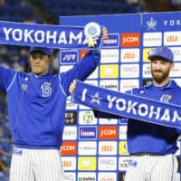 BayStars pitchers Spencer Patton (right) and Shoichi Ino celebrate during their hero interview on Thursday in Yokohama. | KYODO