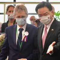 Czech Senate President Milos Vystrcil is greeted by Taiwanese Foreign Minister Joseph Wu upon his arrival at the airport in Taoyuan on Sunday. | AFP-JIJI