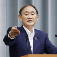 Chief Cabinet Secretary Yoshihide Suga speaks at a news conference Monday at the Prime Minister's Office. | KYODO