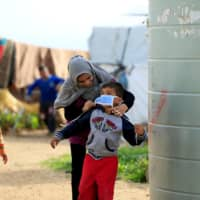 Locked out by the pandemic, refugees' lives are put on hold