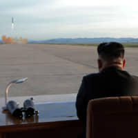 North Korean leader Kim Jong Un watches the launch of a Hwasong-12 intermediate range ballistic missile in this photo released on Sept. 16.  | KCNA / VIA REUTERS