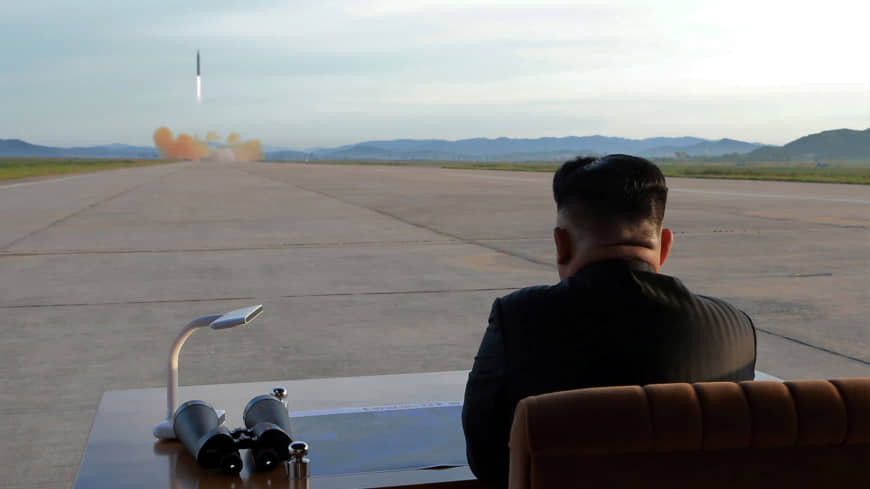North Korean leader Kim Jong Un watches the launch of a Hwasong-12 intermediate range ballistic missile in this photo released on Sept. 16.