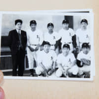 A photo of Yoshihide Suga (back row, far right) from the collection of a classmate shows the future Prime Ministers   with his school baseball team, when he was around 14 years old.