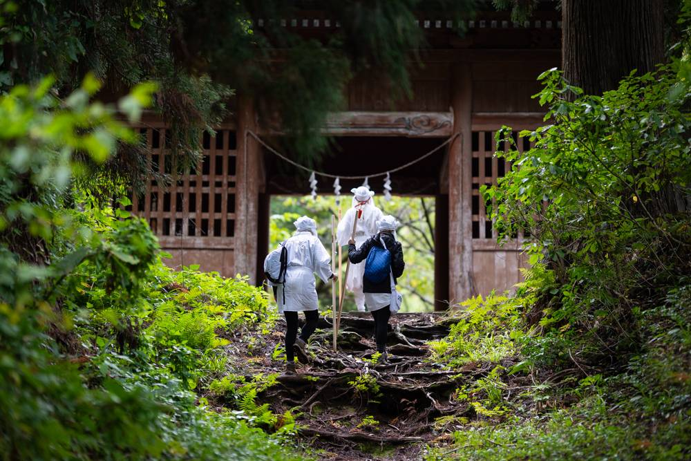 Back to basics: People participate in a training program for mountain ascetic hermits in Yamagata Prefecture. | COURTESY OF DEREK YAMASHITA