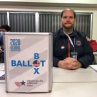 Rock the vote: John Baumlin is advising Americans living abroad to vote early in this year's presidential election. | COURTESY OF DEMOCRATS ABROAD JAPAN