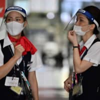 Safety measures, such as masks, are now commonplace at airports, but the creation of a more sophisticates health monitoring system is crucial to allowing more international travel. | AFP-JIJI