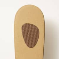 Eco-shoes: The soles are made from five layers of strong corrugated cardboard, and the straps are 100 percent cotton. The sandals have a nonslip underside. |