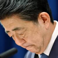 Bowing out: Prime Minister Shinzo Abe bows after announcing his intention to resign on Aug. 28. | KYODO