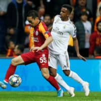 Galatasaray's Yuto Nagatomo competes against Real Madrid's Rodrygo during a Champions League match on Oct. 22, 2019, in Istanbul. | REUTERS
