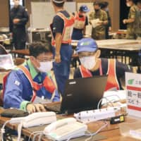 Mie Prefecture officials take part in a disaster drill at the prefectural government office Tuesday, based on the scenario of a massive Nankai Trough earthquake. | KYODO