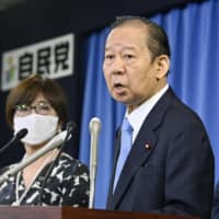 Liberal Democratic Party Secretary-General Toshihiro Nikai speaks to reporters at the party's headquarters in Tokyo after an executive meeting Tuesday. | KYODO