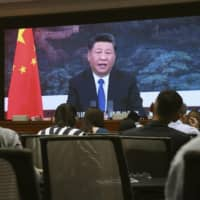China, under President Xi Jinping, has been seeking to build ties through the distribution of masks to virus-hit countries. | KYODO