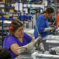 Workers assemble appliances at the Whirlpool manufacturing plant in Cleveland, Tennessee. | REUTERS