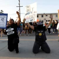 Demonstrators protest against the shooting of Dijon Kizzee by Los Angeles sheriff's deputies in Los Angeles on Tuesday.  | REUTERS
