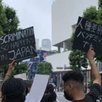 On the march: A mix of people took to the streets for peaceful marches in support of Black Lives Matter across Japan this summer. | ERIC MARGOLIS