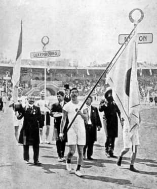 The uniform and spikes of sprinter Yahiko Mishima (center), Japan's flagbearer at the 1912 Stockholm Olympics, is among items of historical value in the collection of the Prince Chichibu Memorial Sports Museum and Library. | KYODO