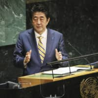 Prime Minister Shinzo Abe delivers a speech at a United Nations General Assembly session in New York on Sept. 24 last year. | POOL / VIA KYODO