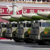 Military vehicles carrying DF-26 ballistic missiles travel past Tiananmen Gate in Beijing during a parade to commemorate the 70th anniversary of the end of World War II on Sept. 3, 2015. | POOL / VIA REUTERS