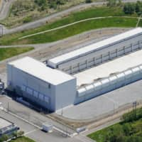 The Nuclear Regulation Authority on Wednesday approved safety measures at a new facility in Mutsu, Aomori Prefecture, to temporarily store spent nuclear fuel prior to reprocessing. | KYODO